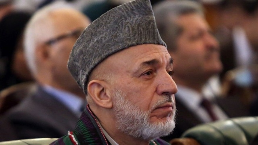 September 23, 2014: Afghan President Hamid Karzai attends his farewell ceremony at the presidential palace in Kabul. (AP Photo/Rahmat Gul)