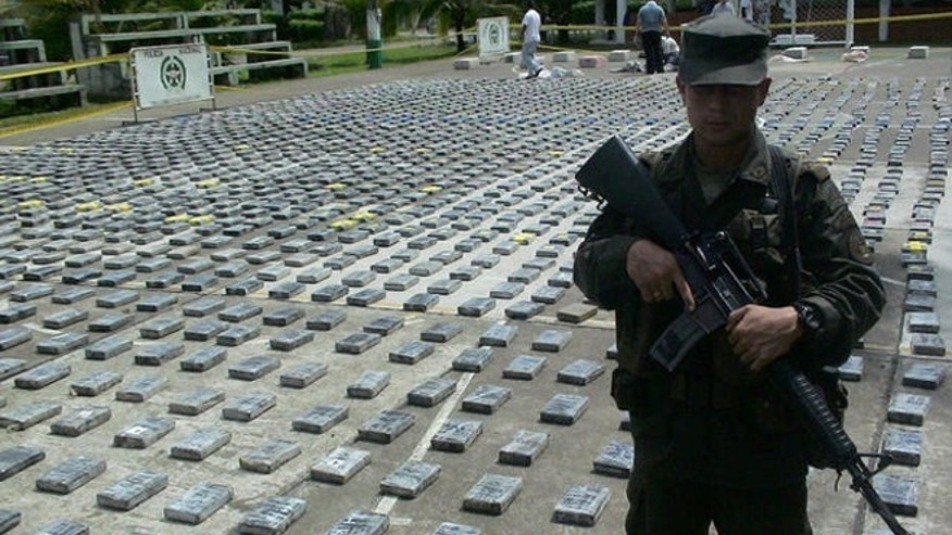 File photo of police guarding packages of cocaine, totaling 2.9 tons, seized in northern Colombia, on June 2006.