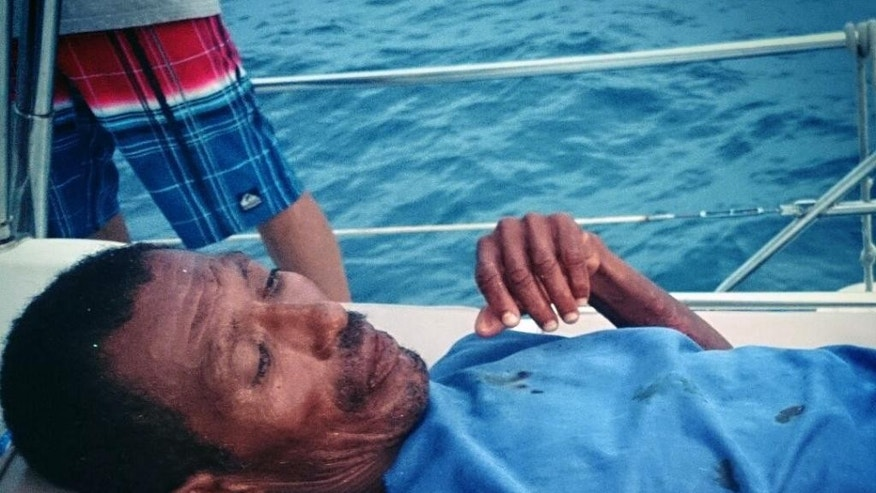 In this Monday, Sept. 22, 2014 photo courtesy of Adonai Vazquez, Mexican fisherman Raymundo Rodriguez, who had been adrift at sea for a week, rests on a boat after he was rescued off the coast of Mexico. Rodriguez was rescued by people aboard a Mexican pleasure boat after his fishing boat was swamped by Tropical Storm Polo. Crew members found the exhausted man as he floated in a giant foam cooler about 6 miles (10 kilometers) off Acapulco. Rodriguez said his fishing companion Mario Morales died farther out to sea. (AP Photo/Courtesy of Adonai Vazquez)