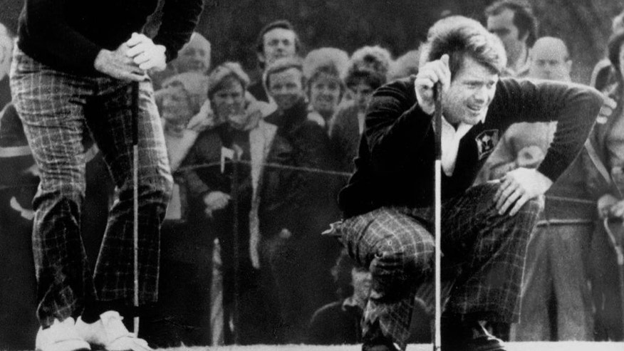 FILE - In this Sept. 15, 1977 file photo, Jack Nicklaus, left, and Tom Watson check the line of a putt, during the first round of the 22nd Ryder Cup golf competition against Britain and Ireland, at Royal Lytham & St. Anne's-on-the-Sea near Blackpool, England. After another convincing US victory, Europeans from the continent such as Severiano Ballesteros were invited to take part in the competition from 1979.  (AP Photo, File)