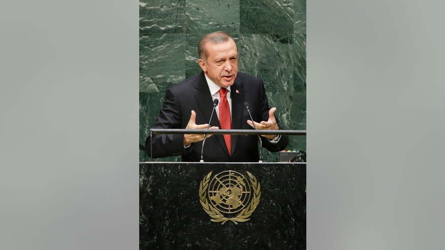 Turkish President Recep Tayyip Erdogan addresses the 69th session of the United Nations General Assembly Wednesday, Sept. 24, 2014, at U.N. headquarters. (AP Photo/Frank Franklin II)