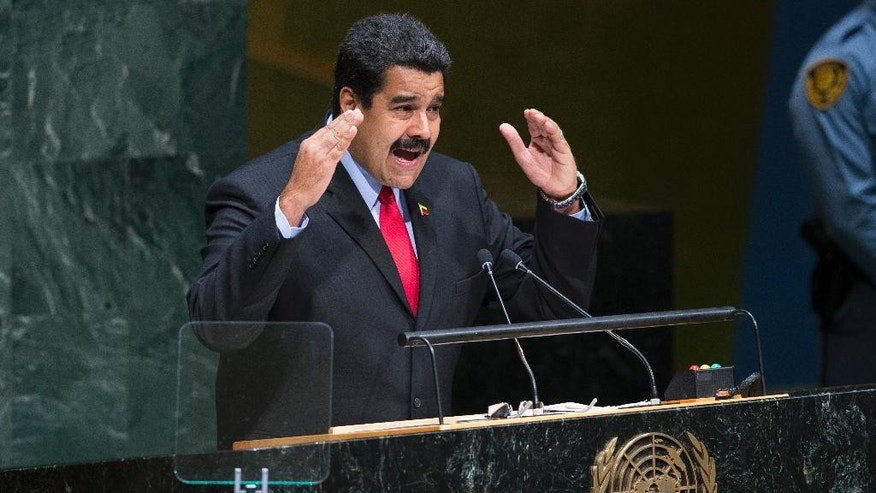 Venezuela's President Nicolas Maduro addresses the 69th session of the United Nations General Assembly, Wednesday, Sept. 24, 2014, at U.N. headquarters. (AP Photo/John Minchillo)