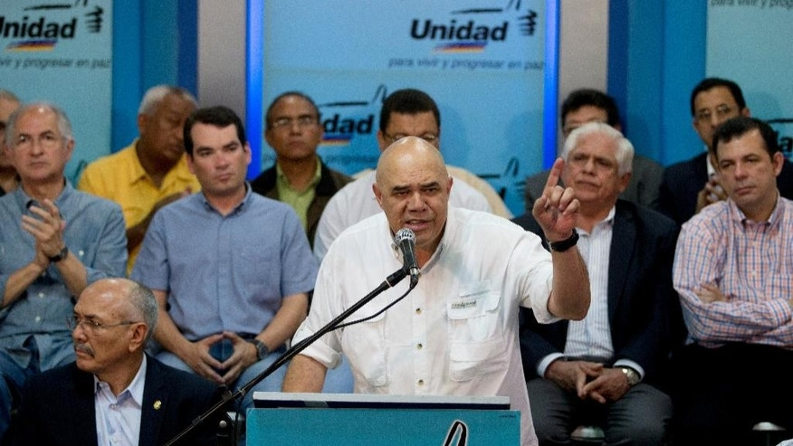 "Jose Torrealba gives a news conference after being appointed executive secretary of Venezuela's opposition coalition ""Mesa de la Unidad Democratica"" (MUD), or Democratic Unity alliance, in Caracas, Venezuela, Wednesday, Sept. 24, 2014. Torrealba, 56, is a radio journalist and former member of the communist party. Torrealba also goes by the name ""Chuo."" (AP Photo/Fernando Llano)"