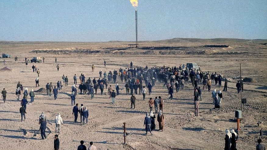 FILE - In this April, 1975 file photo, Syria opens its fourth oil field at Jbeissah, 19 miles west of the Iraq Border. Activists say that U.S.-led airstrikes have targeted Syrian oil installations held by the militant Islamic State group, killing at least five people on Thursday, Sept. 25, 2014. The Britain-based Syrian Observatory for Human Rights and two local activist collectives say the airstrikes hit refineries and oil fields in the eastern provinces of Deir el-Zour and Hassakeh.(AP Photo/Harry Koundakjian, File)