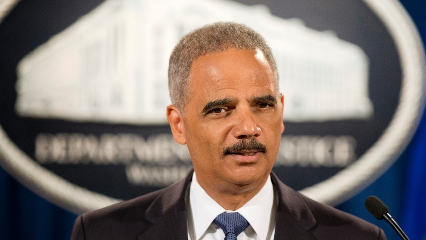 FILE - In this Sept. 4, 2014 file photo, Attorney General Eric Holder speaks during a news conference at the Justice Department in Washington. A White House official says Attorney General Eric Holder is resigning. (AP Photo/Pablo Martinez Monsivais, File)