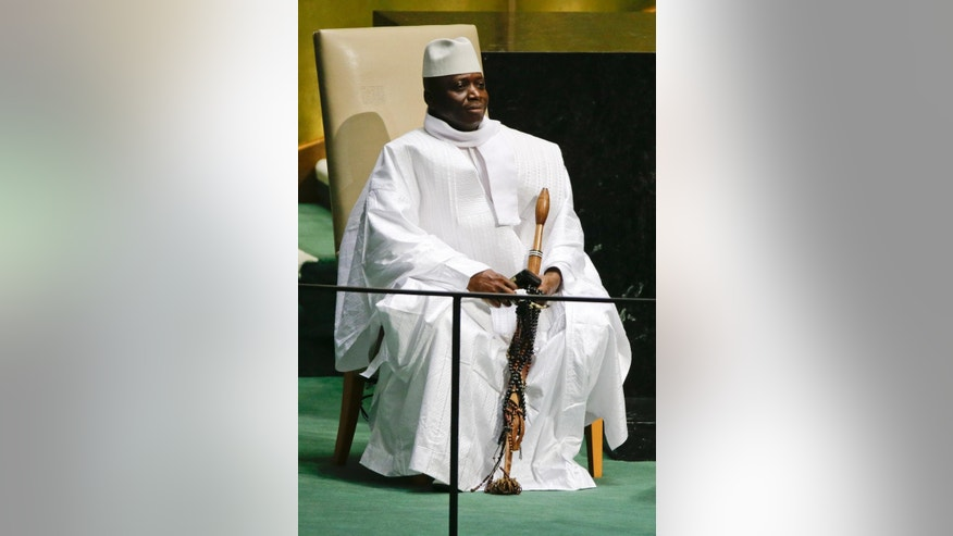 Gambia's President Al Hadji Yahya Jammeh waits to address the 69th session of the United Nations General Assembly Thursday, Sept. 25, 2014, at the United Nations headquarters. (AP Photo/Frank Franklin II)