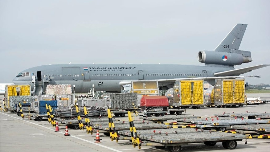 Containers with military equipment for Iraq in front of a Dutch air force plane at the airport in Leipzig, central Germany, Wednesday, Sept. 24, 2014. The first German delivery of weapons and ammunition to Iraq had to be postponed due to a technical problem of the Dutch plane. (AP Photo/Jens Meyer)