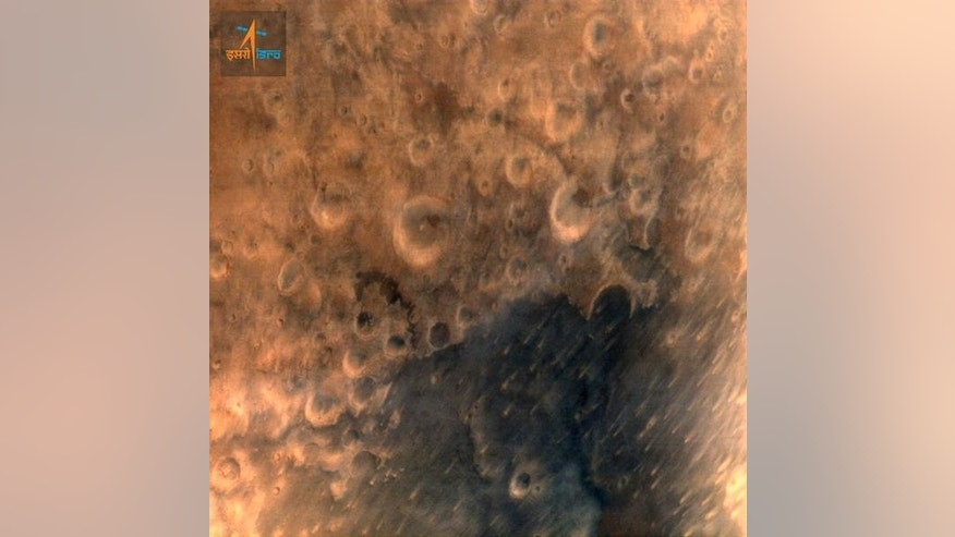 This image provided by the Indian Government Press Information Bureau shows what the agency says is one of the first images of the surface of Mars taken by India's Mars Orbiter Mission satellite, on Thursday, Sept. 25, 2014. The image was taken while the Martian Orbiter Mission, or MOM, was about 7,300 kilometers (4,536 miles) from the planet's surface, according to the Indian Space and Research Organisation. It took at least 12 minutes for the digital data to reach Earth. (AP Photo/Press Information Bureau)