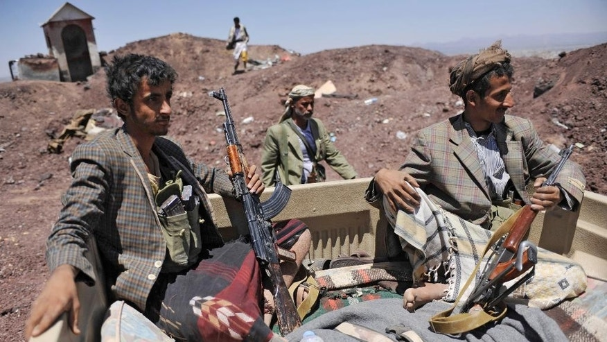 Hawthi Shiite rebels ride in a pickup truck at the compound of the army's First Armored Division, after taking it over, in Sanaa, Yemen, Monday, Sept. 22, 2014. Heavily armed Yemeni Shiite militiamen took over the headquarters and house of a powerful army general allied to Sunni Islamists on Monday and set up checkpoints across the capital, Sanaa, after sweeping across the city as the general and his allies fled and went into hiding. (AP Photo/Hani Mohammed)