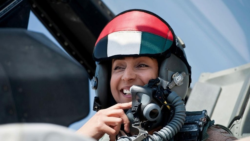 In this June 13, 2013 photo provided by the Emirates News Agency, WAM, sMaj. Mariam al-Mansouri, the first Emirati female fighter jet pilot prepare to take off, in United Arab Emirates. A senior United Arab Emirates diplomat says the Gulf federation's first female air force pilot helped carry out airstrikes against Islamic State militants earlier this week. The Emirati embassy in Washington said on its official Twitter feed Thursday, Sept. 25, 2014 that Ambassador Yousef al-Otaiba confirmed the F-16 pilot's role. Rumors had swirled on social media that Maj. Mariam al-Mansouri was involved in the strikes, but Emirati officials had not previously confirmed that was the case.(AP Photo/Emirates News Agency, WAM)