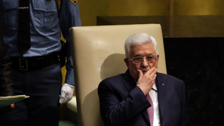 Palestinian President Mahmoud Abbas sit in the ceremonial chair after his addresses to the 69th session of the United Nations General Assembly, at U.N. headquarters, Friday, Sept. 26, 2014. (AP Photo/Richard Drew)