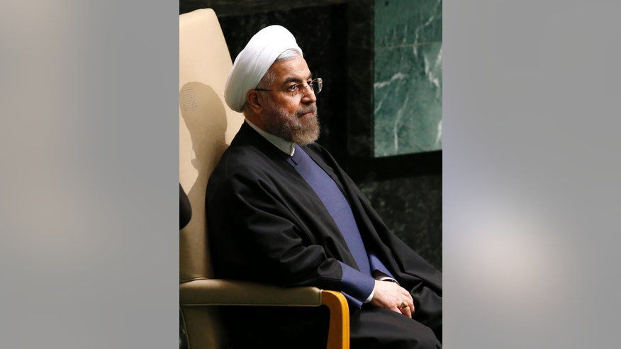 Iranian President Hassan Rouhani sits after addressing the 69th session of the United Nations General Assembly at U.N. headquarters, Thursday, Sept. 25, 2014. In a wide-ranging speech, Rouhani warned world leaders at the U.N. General Assembly that the goal of extremists creating chaos in the Mideast is the destruction of civilization and rise of Islamophobia. He also said a nuclear agreement is possible before the November deadline if the West wants a deal and shows flexibility. (AP Photo/Jason DeCrow)