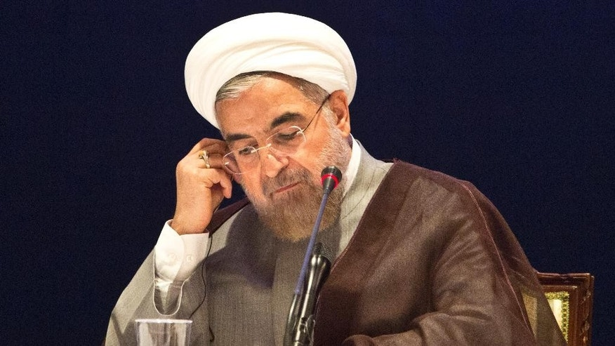 "Iranian President Hassan Rouhani adjusts a translation headphone during a news conference in New York on Friday, Sept. 26, 2014. In his wide-ranging speech to the U.N. General Assembly on Thursday, Rouhani warned that Islamic terrorists were creating chaos in the Mideast to destroy civilization and generate anti-Muslim hatred, saying they wanted to create ""a fertile ground for further intervention of foreign forces in our region."" He also said a nuclear agreement was possible before the November deadline if the West wants a deal and shows flexibility. (AP Photo/Bebeto Matthews)"