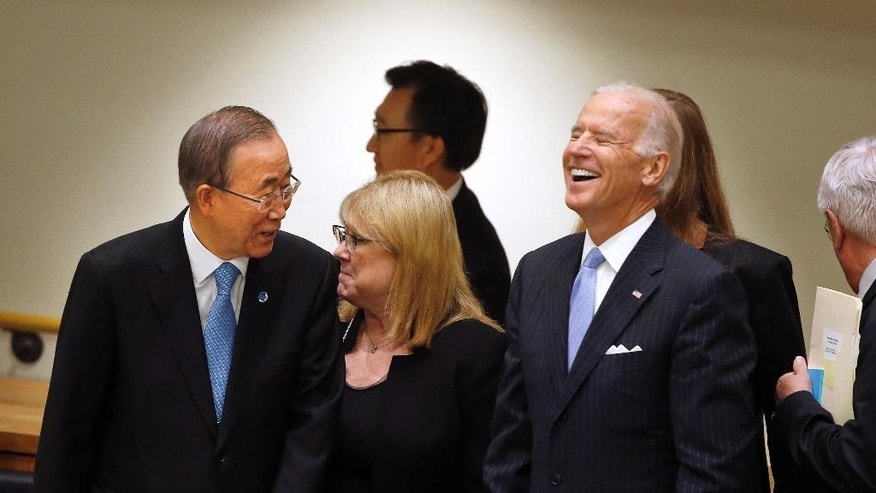 U.S. Vice President Joe Biden, right, laughs while speaking to United Nations Secretary-General Ban Ki-moon before a summit on international peacekeeping operations on the sidelines of the 69th session of the United Nations General Assembly at U.N. headquarters, Friday, Sept. 26, 2014. (AP Photo/Jason DeCrow)
