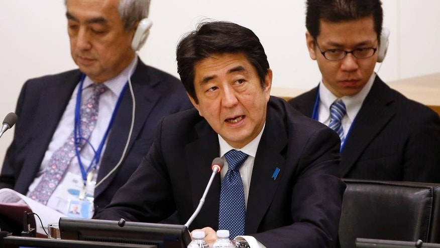 Prime Minister Shinzo Abe of Japan addresses a summit on international peacekeeping operations on the sidelines of the 69th session of the United Nations General Assembly at U.N. headquarters, Friday, Sept. 26, 2014. (AP Photo/Jason DeCrow)