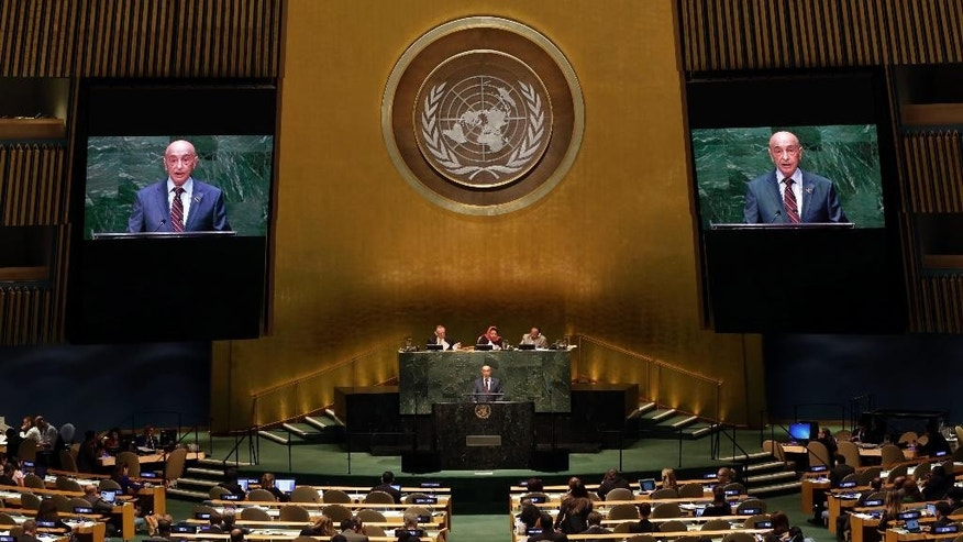 Agila Saleh Essa Gwaider, President of the House of Representatives, of Libya, addresses the 69th session of the United Nations General Assembly, at U.N. headquarters, Saturday, Sept. 27, 2014. (AP Photo/Richard Drew)