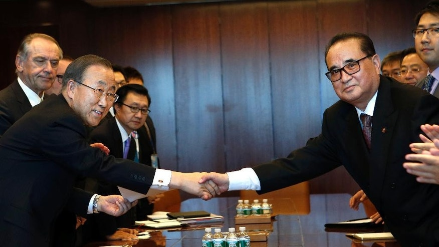 North Korean Foreign Minister Ri Su Yong, right, shakes hands with United Nations Secretary-General Ban Ki-moon during a meeting on the sidelines of the 69th session of the U.N. General Assembly at U.N. headquarters, Sept. 27, 2014. (AP Photo/Jason DeCrow)