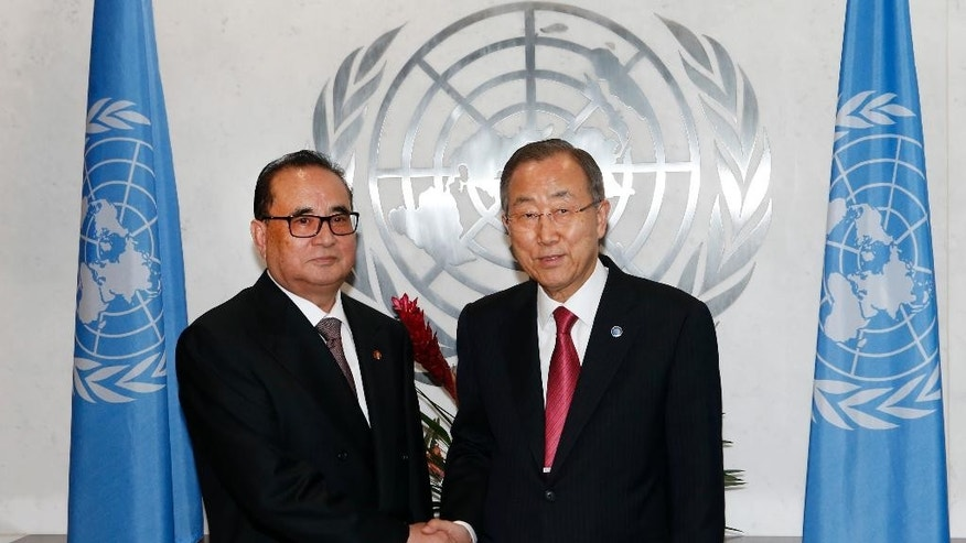 North Korean Foreign Minister Ri Su Yong, left, meets with United Nations Secretary-General Ban Ki-moon on the sidelines of the 69th session of the U.N. General Assembly at U.N. headquarters, Sept. 27, 2014. (AP Photo/Jason DeCrow)