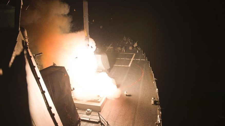FILE -- In this Sept. 23, 2014 file photo released by the U.S. Navy, the destroyer USS Arleigh Burke launches Tomahawk cruise missiles at Islamic State group targets. The U.S. is struggling to counter anger among the opposition in Syria, where many believe that the air campaign against extremists in the country is only helping President Bashar Assad and that Washington is coordinating with Damascus, despite American insistence it backs the rebel cause. (AP Photo/U.S. Navy, Carlos Vazquez, File)