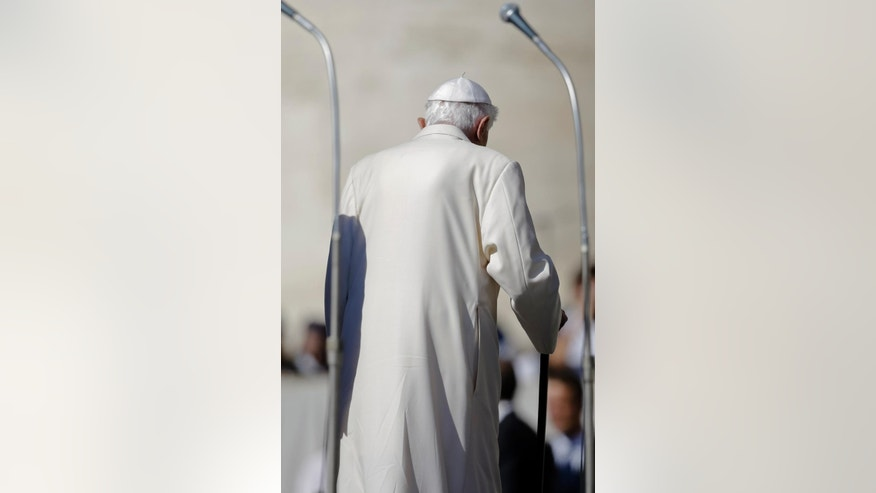 Pope Emeritus Benedict XVI leaves at the end of a meeting with elderly faithful in St. Peter's Square, at the Vatican, Sunday, Sept. 28, 2014. (AP Photo/Gregorio Borgia)