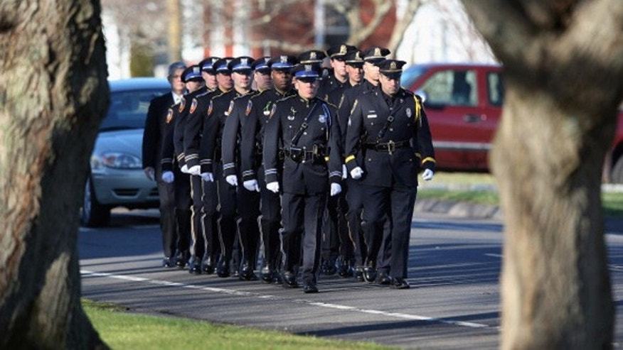 STRATFORD, CT - DECEMBER 19:  A police honor guard arrives for funeral services for slain teacher Victoria Soto, 27, at the Lordship Community Church on December 19, 2012 in Stratford, Connecticut. The first grade teacher reportedly died while trying to protect her students during last Friday's shooting massacre at Sandy Hook Elementary School in Newtown.  (Photo by John Moore/Getty Images)