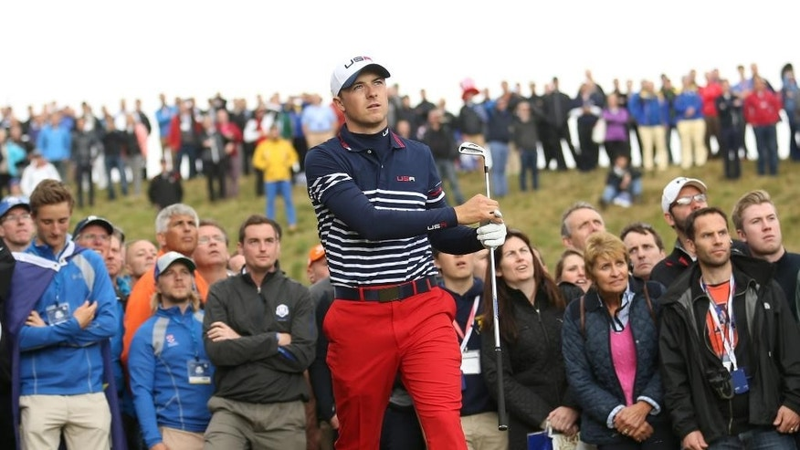 Jordan Spieth of the US watches his shot out of the rough on the 2nd hole during the singles match on the final day of the Ryder Cup golf tournament, at Gleneagles, Scotland, Sunday, Sept. 28, 2014. (AP Photo/Peter Morrison)