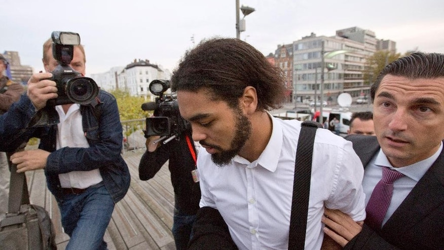 Co- defendant and key witness Jejoen Bontinck, center left, arrives with his lawyer Kris Luyckx to the main courthouse in Antwerp, Belgium on Monday, Sept. 29, 2014. Dozens of Belgians on Monday are going on trial accused of leading or being members of a terrorist organization that allegedly recruited fighters for jihadi groups in Syria. The case, one of the biggest-ever terror trials in Belgium, centers on the radical Muslim group Sharia4Belgium and its members. (AP Photo/Virginia Mayo)