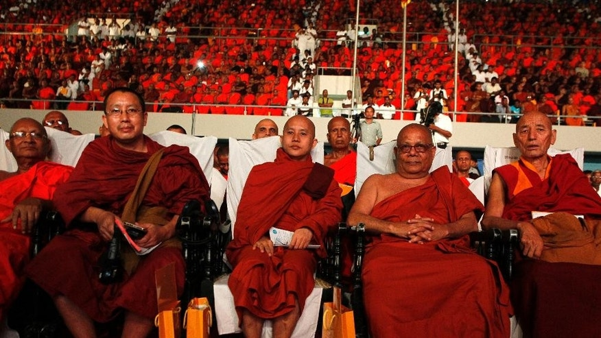 "Myanmar's hard-line Buddhist monk Ashin Wirathu, center, sits with other delegates at a convention organized by Sri Lanka's Bodu Bala Sena or Forces of Buddhist Power in Colombo, Sri Lanka, Sunday, Sept. 28, 2014.Wirathu, known for his anti-Muslim stance, says his movement will join hands with a like-minded Sri Lankan group to protect Buddhists, whom he calls a ""threatened"" world minority.(AP Photo/Eranga Jayawardena)"