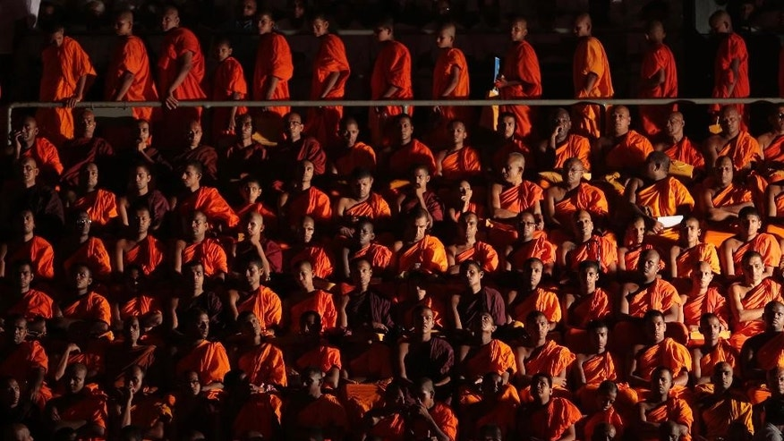 "Sri Lankan Buddhist monks listen to Myanmar's hard-line Buddhist monk Ashin Wirathu at a convention organized by Sri Lanka's Bodu Bala Sena or Forces of Buddhist Power in Colombo, Sri Lanka, Sunday, Sept. 28, 2014.Wirathu, known for his anti-Muslim stance, says his movement will join hands with a like-minded Sri Lankan group to protect Buddhists, whom he calls a ""threatened"" world minority.(AP Photo/Eranga Jayawardena)"