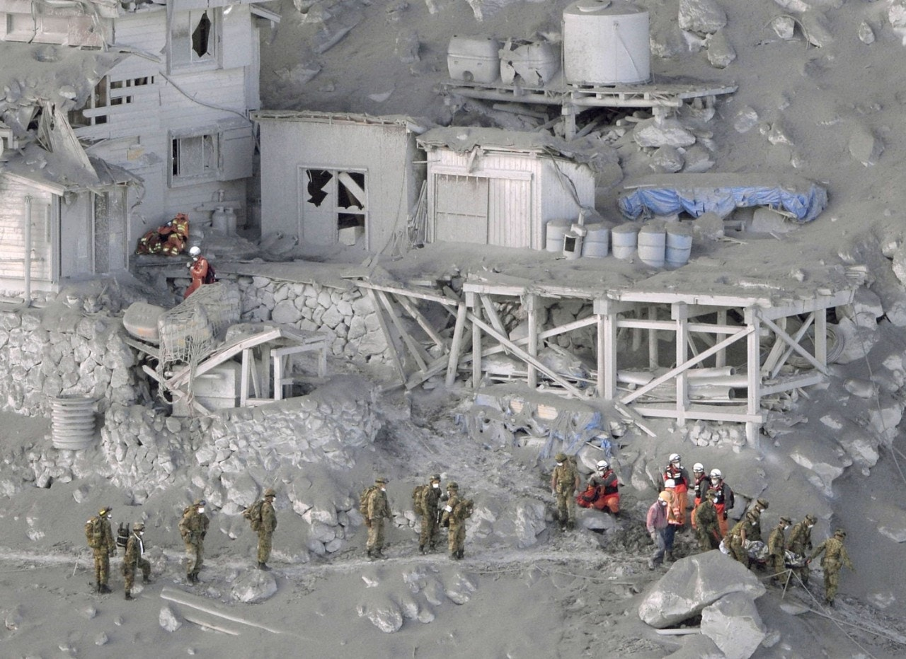 At least 36 presumed dead as recovery of bodies halted at Japanese volcano