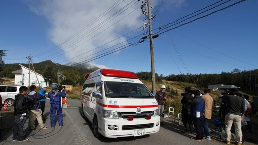 September 29, 2014: An ambulance departs from the Otaki entrance point as Mount Ontake continues to erupt for the third day in Otaki village, in Nagano prefecture, Japan. (AP Photo/Koji Ueda)