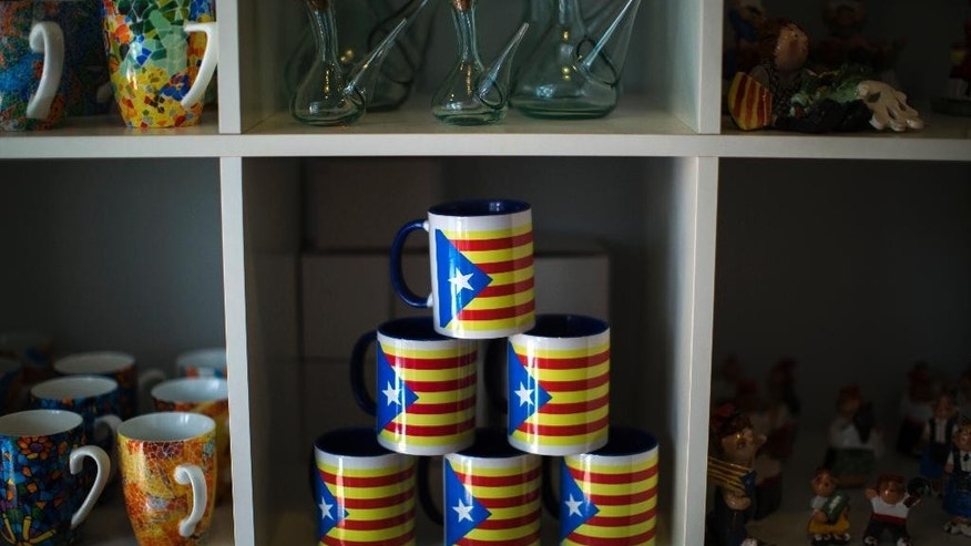 "Cups decorated with ""estelada"" flags, that symbolize Catalonia's independence, are on sale in Barcelona, Spain, Monday, Sept. 29, 2014. The Spanish government is holding a special cabinet meeting and is expected to announce it intends to challenge the decision of the powerful northeastern region of Catalonia to call an independence referendum. Unhappy at Spain's refusal to give it more powers, Catalonia has long vowed to hold the referendum Nov. 9. Catalan regional leader Artur Mas formally called the vote Saturday, posing one of the most serious challenges for the Spanish state in recent years. The Spanish government is expected to take the case to the top Constitutional Court. (AP Photo/Emilio Morenatti)"