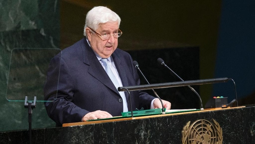 Syria's Deputy Prime Minister Walid Al-Moualem addresses the 69th session of the United Nations General Assembly at U.N. headquarters, Monday, Sept. 29, 2014. (AP Photo/John Minchillo)