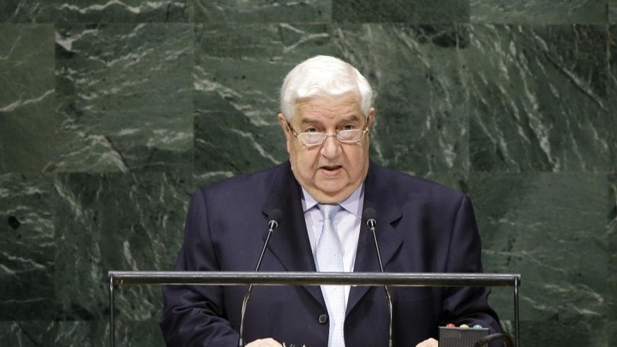 Walid Al-Moualem, Deputy Prime Minister of Syria, speaks during the 69th session of the United Nations General Assembly at U.N. headquarters, Monday, Sept. 29, 2014. (AP Photo/Seth Wenig)