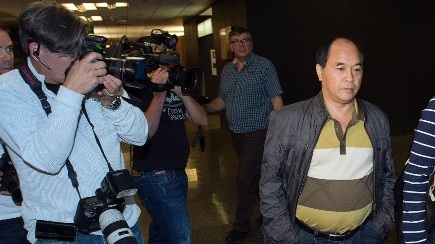 Diran Lin, father of victim Jun Lin, walks to the courtroom for the murder trial of Luka Rocco Magnotta in Montreal, Monday, Sept. 29, 2014. Magnotta is accused of dismembering Concordia student Jun Lin and mailing the body parts to political parties and schools. (AP Photo/The Canadian Press, Ryan Remiorz)
