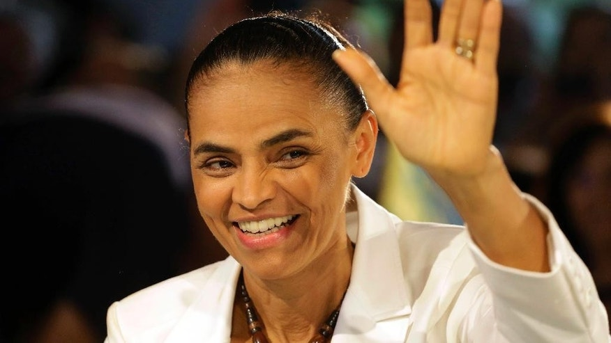 Marina Silva, presidential candidate of the Brazilian Socialist Party, PSB, waves to supporters during a campaign meeting in Sao Paulo, Brazil, Tuesday, Sept. 30, 2014. Brazil will hold general elections in Oct. 5. (AP Photo/Nelson Antoine)