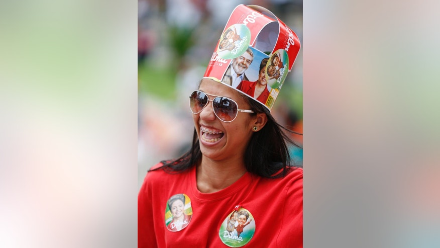 A supporter of Brazil's President Dilma Rousseff, who is running for reelection with the Workers Party (PT), wears a hat at Rousseff's campaign rally in Santos, Brazil, Tuesday, Sept. 30, 2014. Brazil will hold general elections on Oct. 5. (AP Photo/Andre Penner)