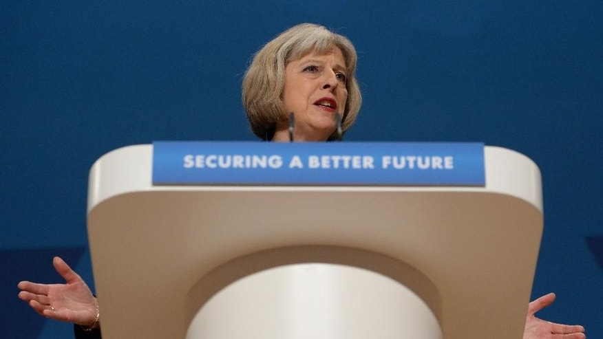 "British Home Secretary Theresa May gives her speech to delegates at the Conservative Party annual conference in Birmingham, England, Tuesday, Sept. 30, 2014. Britain's interior minister says people with extremist views could be barred from appearing on television or publishing on social media even if they are not breaking any laws. Home Secretary Theresa May told a conference of the governing Conservatives that if re-elected next year the party will introduce powers to disrupt people who ""spread poisonous hatred"" while staying within the law. May said Tuesday that only a minority of extremists are violent, but there is ""a thread that binds"" nonviolent extremism to terrorism. (AP Photo/Stefan Rosseau, PA Wire)     UNITED KINGDOM OUT      -    NO SALES    -   NO ARCHIVES"
