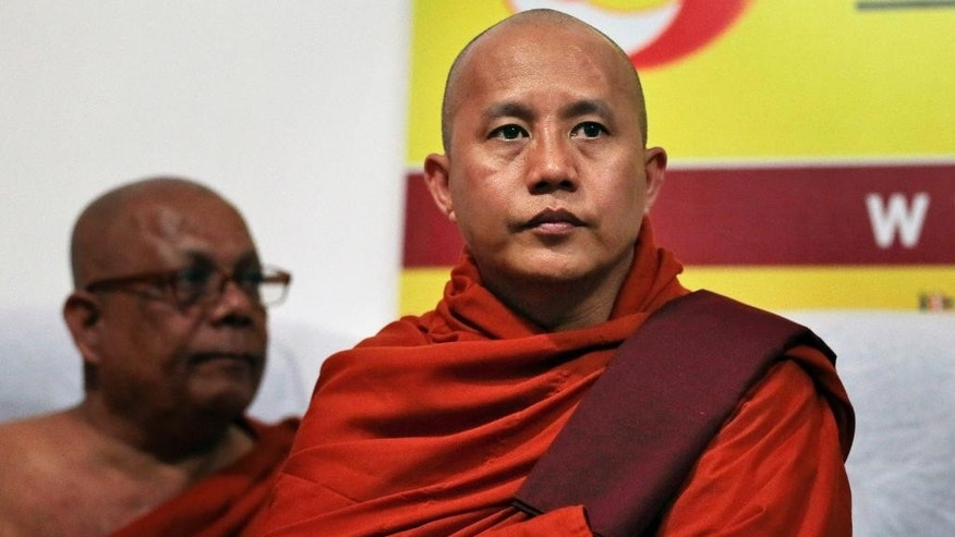 Myanmar's radical Buddhist monk Ashin Wirathu attends a media briefing in Colombo, Sri Lanka, Tuesday, Sept. 30, 2014. Wirathu, known for his anti-Muslim campaign, has formalized an agreement with a like-minded Sri Lankan Bodu Bala Sena or Buddhist Power Force to work together to protect Buddhism which he says is challenged worldwide. (AP Photo/Eranga Jayawardena)