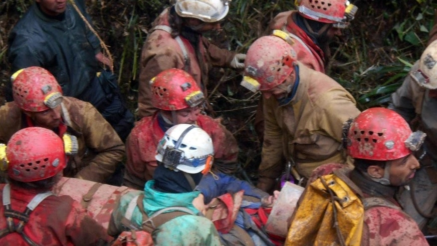 Rescue workers carry injured Spanish speleologist Cecilio Lopez after his rescue from inside the Inti Machay cave, in Leimebamba, Peru, Tuesday, Sept. 30, 2014. Lopez, a well-known cave explorer, was hurt when he fell inside the Inti Machay cave, where he remained trapped underground for 12 days in Peru's remote Amazon region. (AP Photo/Mauricio Munoz)