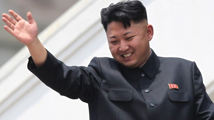 FILE - In this July 27, 2013 file photo, North Korean leader Kim Jong-un waves to war veterans during a mass military parade celebrating the 60th anniversary of the Korean War armistice in Pyongyang. (AP Photo/Wong Maye-E, File)