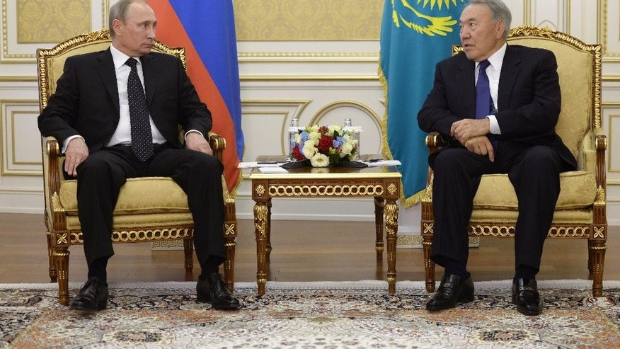 Kazakhstan's President Nursultan Nazarbayev, right, and visiting Russian President Vladimir Putin meet during the Kazakh-Russian talks in Atyrau, Kazakhstan on Tuesday Sept. 30, 2014. (AP Photo/RIA Novosti, Alexei Nikolsky, Presidential Press Service)
