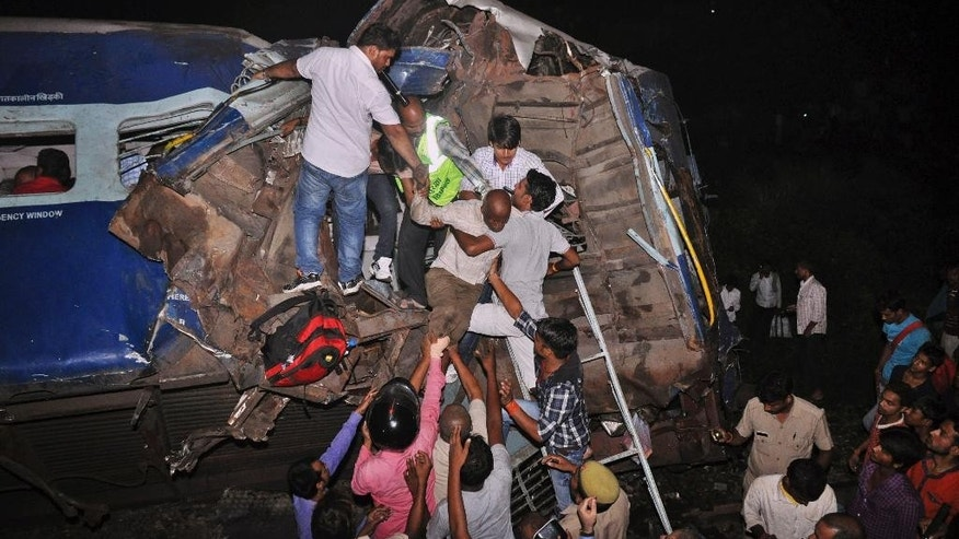 Sept. 30, 2014:  Passengers are rescued from a damaged train near Gorakhpur city, India.