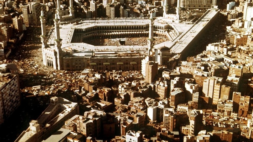 FILE- This 1988 file photo shows an aerial view of Mecca and the holy Kaaba in Grand Mosque. As Muslims from around the world stream into Mecca for the annual hajj pilgrimage this week, they come to a city undergoing the biggest transformation in its history. (AP Photo, File)