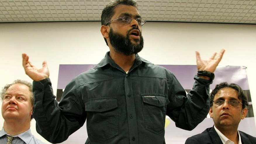 Feb. 28, 2009:  file photo of former Guatanamo detainee Moazzam Begg, who was released in 2005, as he speaks during a session of the Convention Modern Liberty at the Institute of Education in London. British prosecutors