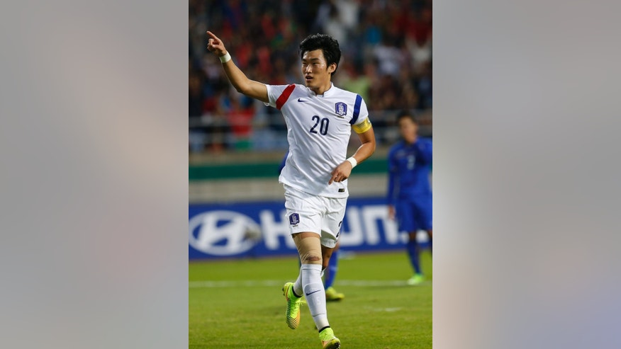 South Korea's Jang Hyunsoo celebrates after scored a goal during the men's football semifinal against Thailandat the 17th Asian Games in Incheon, South Korea, Tuesday, Sept. 30, 2014.  (AP Photo/Kin Cheung)