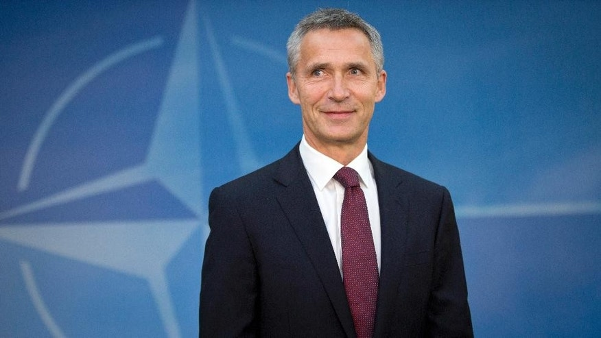 New NATO Secretary General Jens Stoltenberg arrives for his first day of work at NATO headquarters in Brussels on Wednesday, Oct. 1, 2014. A two-time prime minister, Stoltenberg became a recognizable face on the international scene with his dignified response to the twin terror attacks that killed 77 people in Norway in July 2011. (AP Photo/Virginia Mayo)