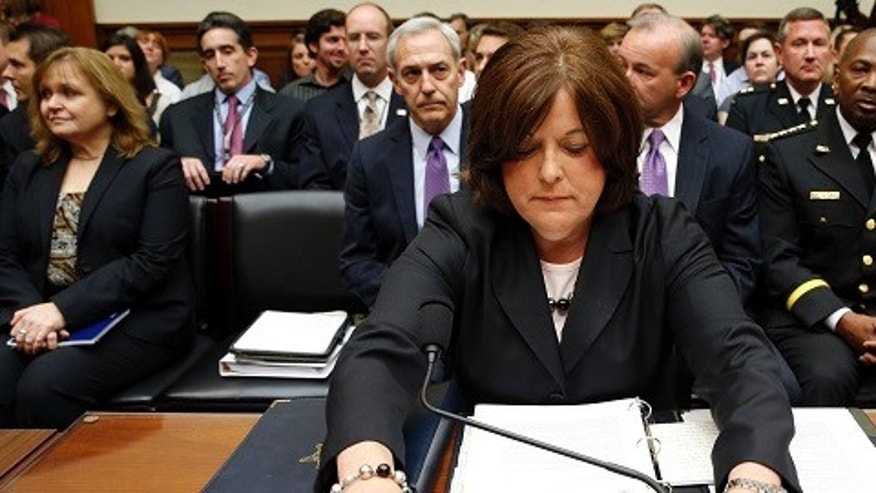 "U.S. Secret Service Director Julia Pierson takes her seat to testify at the House Oversight and Government Reform Committee hearing on ""White House Perimeter Breach: New Concerns about the Secret Service"" on Capitol Hill in Washington Sept. 30, 2014. (REUTERS/Kevin Lamarque)"