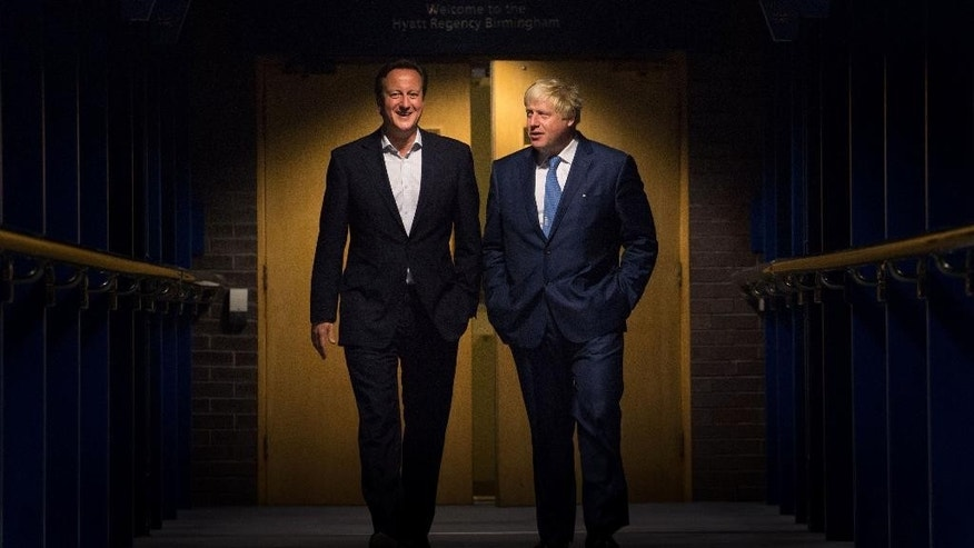 British Prime Minister David Cameron, left and The Mayor of London, Boris Johnson walk through the International Convention Centre, (ICC), in Birmingham, England, Monday, Sept. 29, 2014, on their way to an event, during the Conservative Party conference. (AP Photo/PA, Stefan Rousseau) UNITED KINGDOM OUT