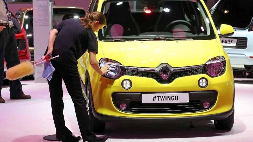 A Renault made Twingo is presented at the Paris Motor Show, in Paris, Thursday Oct. 2, 2014. The Paris Motor Show will open its doors to the public on Saturday Oct. 4, until Oct. 19.  European carmakers are hoping to impress with new models at this week's Paris Motor Show and prove they have come out stronger from years of economic trouble and cost-cutting. (AP Photo/Remy de la Mauviniere)